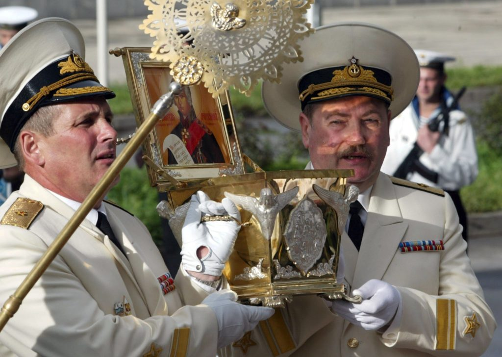 MOS01 - 20020828 - VLADIVOSTOK, RUSSIAN FEDERATION : Russian Navy admirals carry a box with remains of the Saint Russian warrior Admiral Fyodor Ushakov, 28 August, 2002. The remains were presented to Vladivostok Church to bless and defend Russian Far East navy in Vladivostok. EPA PHOTO EPA SERGEI CHIRIKOV